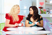 Plus size women sitting in cafe — Stock Photo