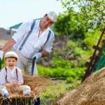 Village lifestyle, family having fun while working on backyard — Stock Photo #45114339