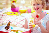 Happy girl on summer picnic party — Stock Photo