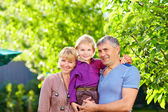 Happy adult parents with small son — Stock fotografie