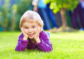 Portrait of cute kid on summer grass — ストック写真