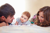 Happy family with infant baby girl at home — Stock Photo