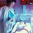 Newborn baby in incubator box, phototherapy — Stock Photo