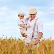 Father and son, farmers on wheat field — Stock Photo #47389321