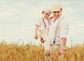 Father and son, farmers on wheat field — Foto de Stock