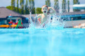 Happy boy kid jumping in the pool — Stock Photo