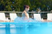 Happy boy kid jumping in the pool — Foto de Stock