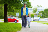 Father and son walking on city street — Stock Photo