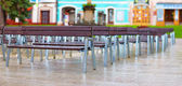 Rows of benches on city street — Stock Photo