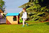 Boy playing near toy house — Zdjęcie stockowe