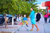 Father and son after shopping in supermarket — Stockfoto