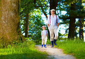Father and son walking the forest path — Stock Photo