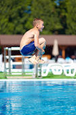 """Excited teenage boy jumping """"bomb"""" in the pool — Stock Photo"""