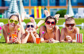 Group of happy friends on summer lawn — Stock Photo