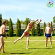 Group of teenage kids playing with ball on summer lawn — Stock Photo #48281873