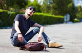 Young adult boy posing on the ground — Stockfoto