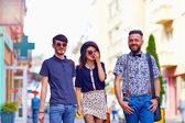 Candid portrait of friends walking the city street — Stock Photo