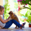 Excited boy playing with beloved puppy — Stock Photo #49207017