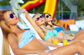 Beautiful girls sunbathing on summer vacation — Stock Photo