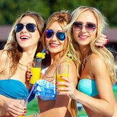 Happy girls with beverages on summer party — Stock Photo
