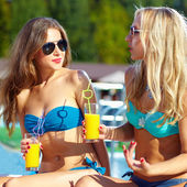 Beautiful girls talking on summer beach — Stock Photo