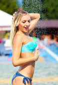 Sexy blonde enjoying summer shower — Stock Photo