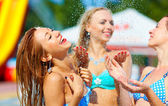 Laughing girls having fun under summer shower — Stock Photo