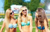 Happy friends talking on summer party — Stock Photo