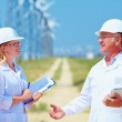 Group of researchers on wind power station — Stock Photo #50720429