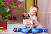 Young boy hugging little puppy — Stock Photo