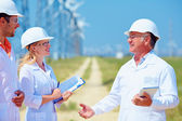 Group of researchers on wind power station — Stock Photo