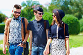 Friends walking on the street, youth culture — Stock Photo