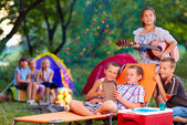 Group of happy kids on summer picnic — Stock Photo