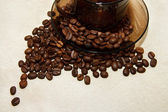 Coffee beans around a cup of coffee — Stock Photo