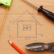 Sketch of a building plan surrounded by different instruments — Stock Photo