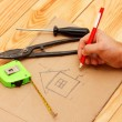 Drawing a building plan with red pencil — Stock Photo #32089731