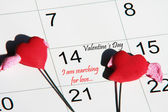 I am searching for love rite in calendar whit red and two hearts — Stock Photo