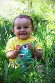 Baby boy, one year old smyling in garden, — Stock Photo