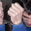 Close-up. Arrested man handcuffed - Stock Photo
