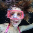 Female diver underwater - Stock Photo