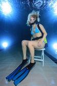 Female scuba diver on chair — Stock Photo