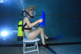 Reading underwater — Stock Photo