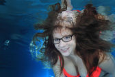 Woman underwater with glasses — Стоковое фото