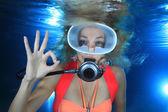 Happy female scuba diver — Stock Photo