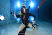 Scuba woman with spear gun — Stock Photo