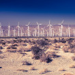 Wind-driven electric power station in desert — Stock Photo