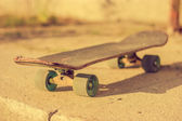 Skateboard on ground — Stock Photo