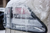 Headlight in the snow — Stock Photo