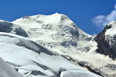 The icy giant Liskamm a dangerous mountain to climb because of the seracs. Viewed from the north in the southern swiss alps above Zermatt — Stock Photo