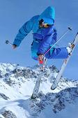 Ski jumper in blue — Stock Photo